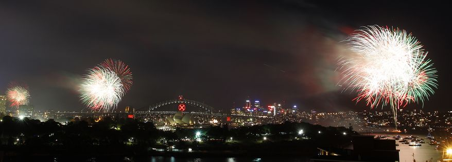 The sky above Sydney Harbor lights up with the 9pm fireworks display on new year's eve in Sydney, Australia, Friday, Dec. 31, 2010. (AP Photo/Rob Griffith)