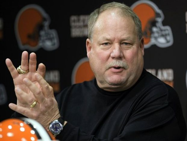 FILE - In a Jan. 12, 2010 file photo,Cleveland Browns president Mike Holmgren answers questions during a news conference announcing Tom Heckert Jr. as the Browns general manager, in Berea, Ohio. Holmgren will decide in the coming days whether to keep coach Eric Mangini for a third season. Holmgren, who took Green Bay and Seattle to the Super Bowl, has left open the possibility of coaching again.  (AP Photo/Tony Dejak, File)