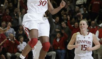 Stanford forward Nnemkadi Ogwumike (30) celebrates with guard Lindy La Rocque (15) after throwing the ball in the air following Stanford's upset of Connecticut, 71-59, ending Connecticut's winning streak at 90 games. (Associated Press)