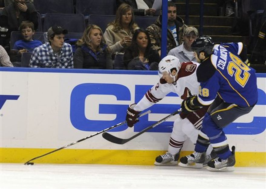 Phoenix Coyotes' Keith Yandle (3) gets around St. Louis Blues' Matt D'Agostini, left, in the second period of an NHL hockey game Friday, Dec. 31, 2010, in St. Louis. (AP Photo/Bill Boyce)