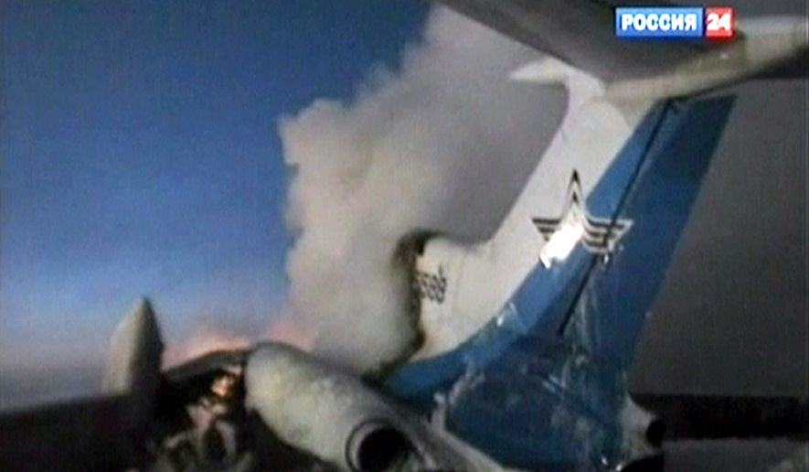 This image taken from the Russia 24 television channel shows the tail of a Russian Tu-154 passenger aircraft after an explosion in Surgut, Russia, about 1,350 miles east of Moscow in Siberia, on Saturday, Jan. 1, 2011. The jet, carrying 128 people, caught fire and later exploded. (AP Photo/Rossia 24 Television Channel)