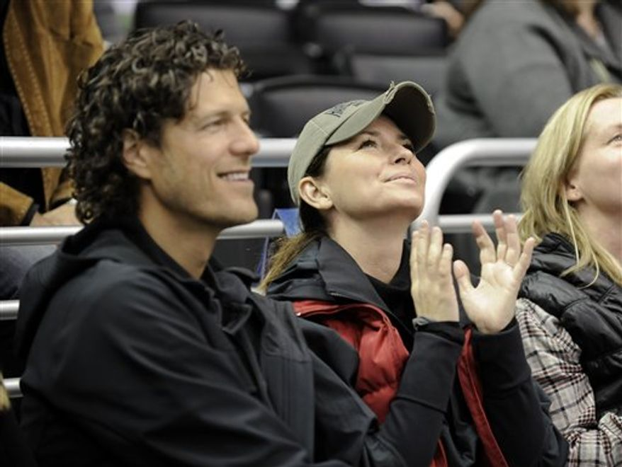 FILE - In this Nov. 6, 2010 file photo, singer Shania Twain sits with Frederic Thiebaud, left, during the third period of an NHL hockey game between the Nashville Predators and the Los Angeles Kings in Los Angeles. The country singer and businessman had a New Year's Day wedding in Puerto Rico on Saturday, Jan. 1, 2011. (AP Photo/Gus Ruelas, file)