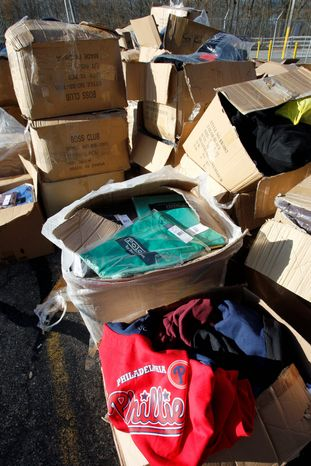 """Counterfeit products swarming the market pose health and economic risks, authorities say, and could be financing terrorist organizations. """"This isn't a victimless crime,"""" said Robert Barchiesi, president of the International AntiCounterfeiting Coalition. (Associated Press)"""