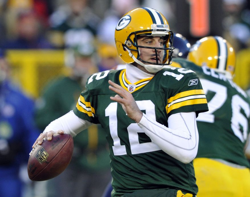 Green Bay Packers quarterback Aaron Rodgers drops back to pass during the first half of an NFL football game against the Chicago Bears on Sunday, Jan. 2, 2011, in Green Bay, Wis. (AP Photo/Jim Prisching)