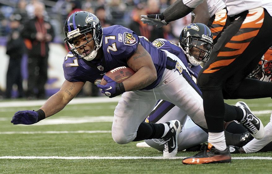 Baltimore Ravens running back Ray Rice dives over the goal line for a touchdown during the second half of an NFL football game against the Cincinnati Bengals in Baltimore, Sunday, Jan. 2, 2011. (AP Photo/Rob Carr)