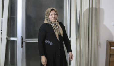 ** FILE ** Iranian Sakineh Mohammadi Ashtiani, who has been sentenced to death by stoning for adultery, arrives for a news briefing in the northwestern Iranian city of Tabriz on Saturday, Jan. 1, 2011. (AP Photo/Vahid Salemi)