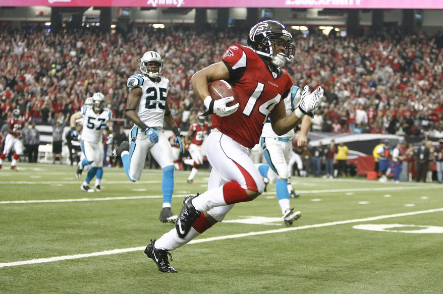 Atlanta Falcons punt returner Eric Weems (14) outruns the Carolina Panthers defense on a first quarter touchdown return during an NFL football game at the Georgia Dome in Atlanta Sunday, Jan. 2, 2011. Defending for the Panthers is: Marcus Hudson (25) and Jordan Senn (57).AP Photo/John Amis)