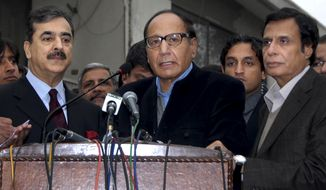 Former Pakistani Prime Minister Chaudary Shujjat Hussain, center, talks to media after meeting with Prime Minister Yousuf Raza Gilani, left, as former Chief Minister of Punjab's province Pervez Ellani, right, looks on, in Lahore, Pakistan, Monday, Jan. 3, 2011. Mr. Gilani tried to keep his government from collapsing after a key party said it was quitting the ruling coalition, leaving the government short of majority support in parliament. (AP Photo)