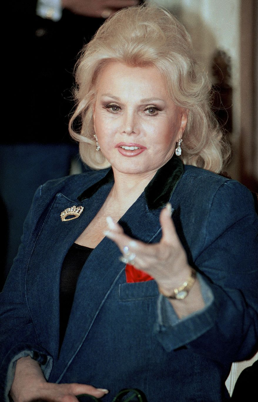 Zsa Zsa Gabor responds to a question during a press conference at her home in the Bel Air section of Los Angeles on April 13, 1992. A representative for the actress said Sunday Jan. 2, 2011, that she is back in a Los Angeles hospital to have part of her leg amputated. (AP Photo/Kevork Djansezian/file)