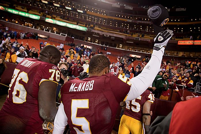 Washington Redskins quarterback Donovan McNabb (5) tips his hat to the crowd as he walks off the field after an NFL football game against the New York Giants on Sunday, Jan. 2, 2011, in Landover, Md.  (AP Photo/Evan Vucci)