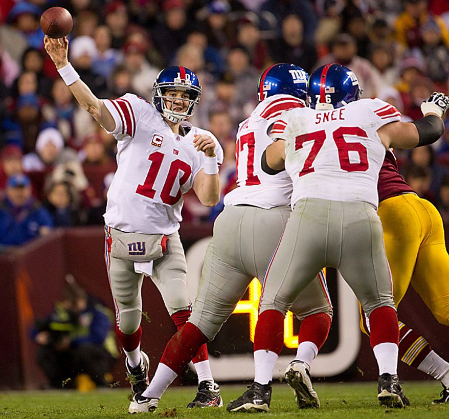 New York Giants quarterback Eli Manning (10) is protected by Giants guard Chris Snee (76) and offensive tackle Kareem McKenzie (67) as he delivers a pass during the first half of an NFL football game against the Washington Redskins on Sunday, Jan. 2, 2011, in Landover, Md.  (AP Photo/Evan Vucci)