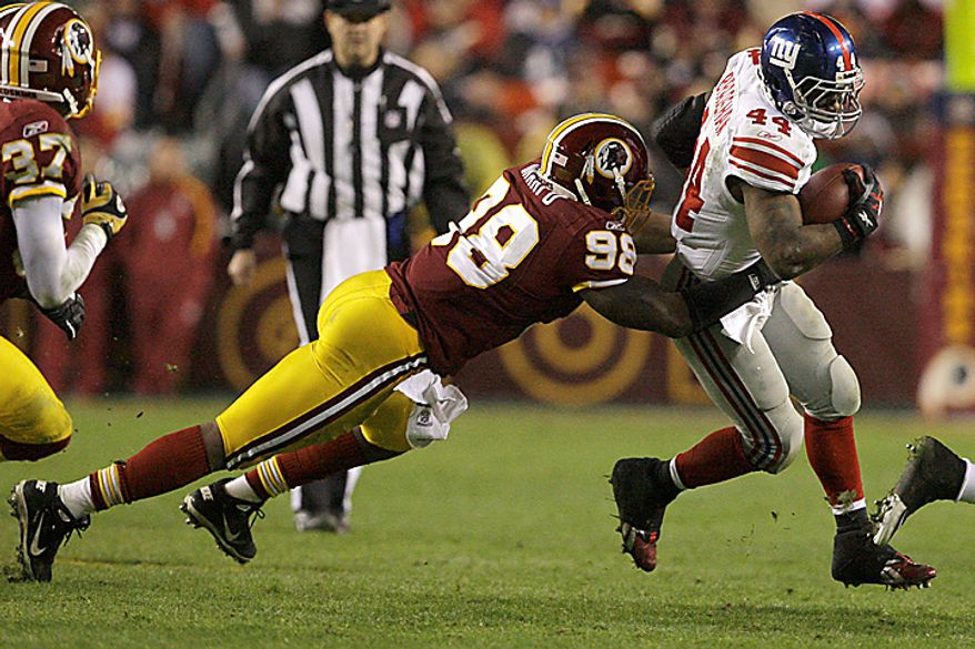 Washington Redskins linebacker Brian Orakpo (98) tackles New York Giants running back Ahmad Bradshaw (44) during the first half of an NFL football game in Landover, Md., on Sunday, Jan. 2, 2011. (AP Photo/Jacquelyn Martin)