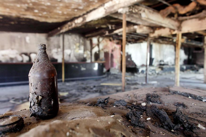 A once-popular nightclub sits abandoned in Cuidad Juarez. The owner said he closed the bar after it was set on fire three times because he refused to pay extortion fees to cartel enforcers. (Associated Press)