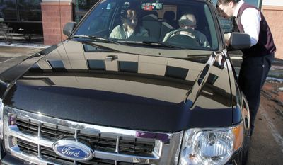 George and Sheila Snyder, of Washington, Vt., take delivery of their 2011 Ford Escape in Montpelier. Ford Motor Co. led a resurgence in vehicle sales, reporting a 19 percent jump over 2009 sales Tuesday and increased its U.S. market share for the second straight year. (Associated Press)