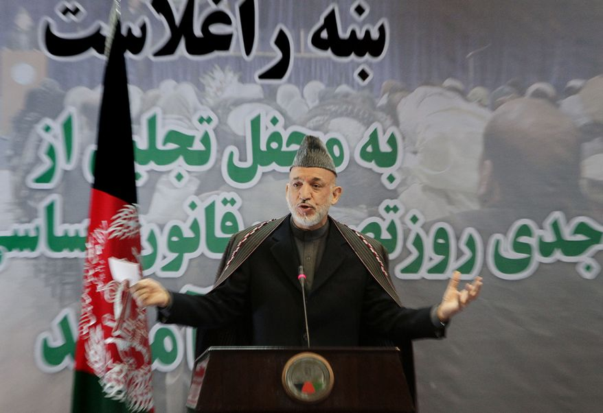 "Afghan President Hamid Karzai speaks in Kabul, Afghanistan, on Tuesday, Jan. 4, 2011, during a gathering to mark the seventh anniversary of the adoption of the Afghanistan Constitution. The writing behind him says, ""Welcome to the adoption day of Afghanistan's Constitution."" (AP Photo/Musadeq Sadeq)"