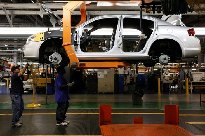 Line workers assemble a 2011 Dodge Avenger at the Chrysler Sterling Heights Assembly plant in Sterling Heights, Mich. Manufacturers produced more goods and booked more orders last month. (Associated Press)