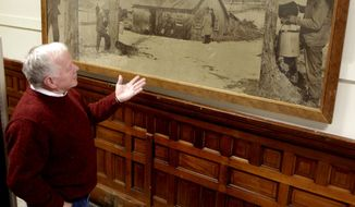 Vermont Agriculture Commissioner Roger Allbee stands by the newly returned Norman Rockwell photo mural on Monday, Jan. 3, 2011, in Montpelier, Vt. (AP Photo/Toby Talbot)