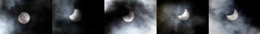 A combo picture shows the different phases of a partial solar eclipse seen in capital Nicosia, Cyprus, Tuesday, Jan. 4, 2011.  (AP Photo/Petros Karadjias)