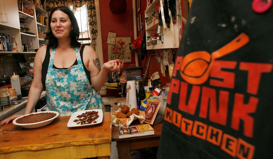 Author Isa Chandra Moskowitz, here in 2007, prepares her vegan chocolate pie recipe at her apartment in New York. Ms. Moskowitz says it's easier being a vegan now because of more local produce available and more interesting ways of cooking. (Associated Press)