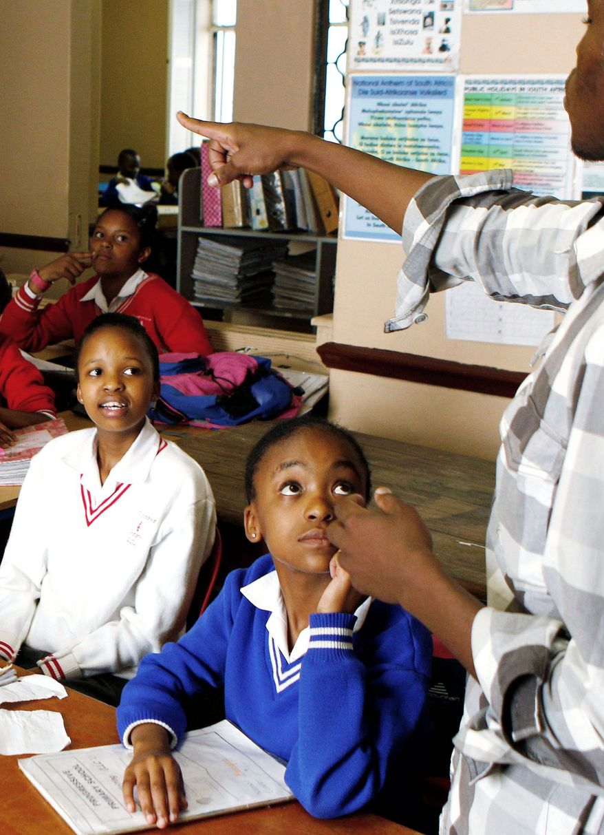 Micheal Mpubane leads a Bible study at the Progressive Primary in Johannesburg. Poor South Africans are underserved by a government that has struggled to close the gap apartheid created between white and black public schools. (Associated Press)