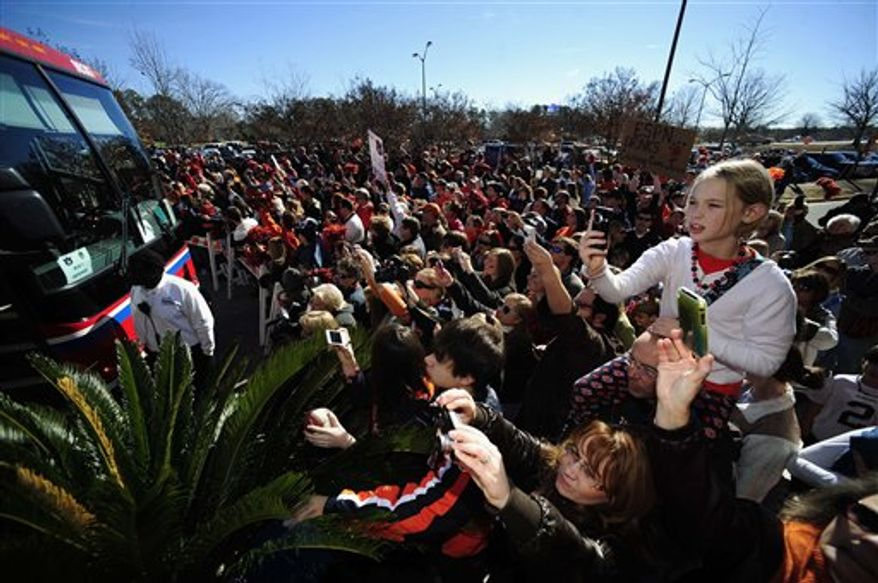 Auburn quarterback Cam Newton tales a self portrait with fans during the team send-off from the Auburn Athletic Complex on Monday, Jan. 3, 2011 in Auburn, Ala. Auburn plays Oregon in the college football BCS Championship Game on Monday.(AP Photo/Cam Newton)