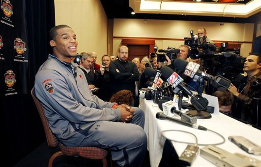 Auburn quaterback Cam Newton speaks during the BCS National Championship media day Friday, Jan. 7, 2011, in Scottsdale, Ariz. Auburn will face Oregon in the BCS National Championship football game on Jan. 10 in Glendale, Ariz. (AP Photo/Matt York)