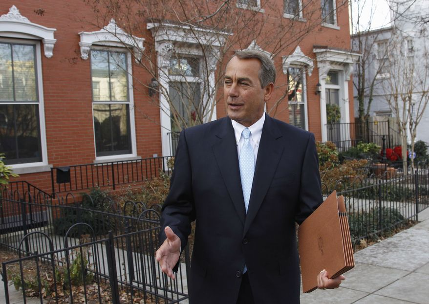 House Speaker-designate John A. Boehner of Ohio walks out of his home on Capitol Hill in Washington Wednesday, Jan. 5, 2011, prior to the start of the 112th Congress. (AP Photo/Alex Brandon)