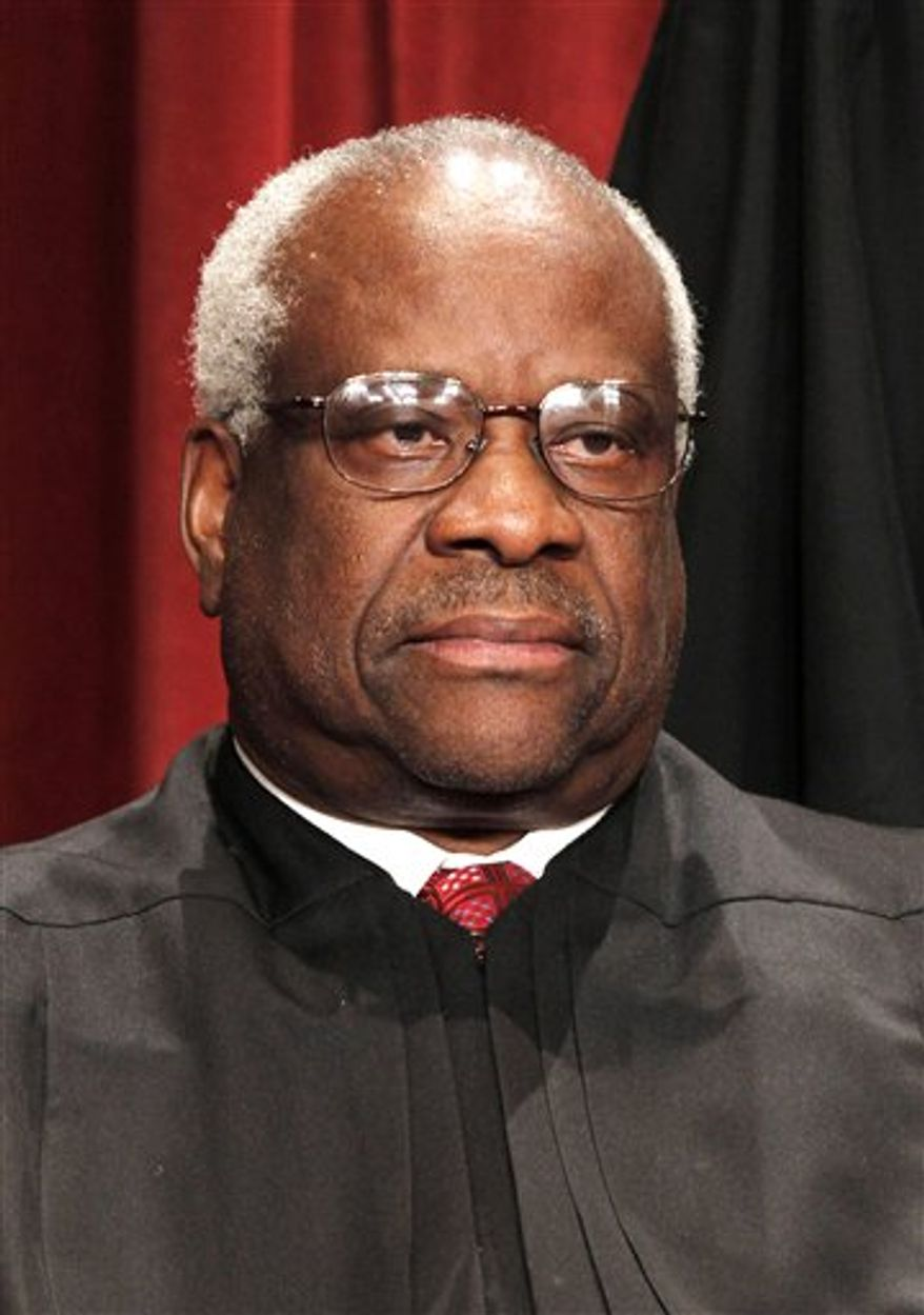 "In this Oct. 8, 2010 photo, Associate Justice Clarence Thomas is seen during the group portrait at the Supreme Court Building in Washington. Lillian McEwen, who dated Thomas in the 1980s, has signed with TitleTown Publishing for her book titled, ""D.C. Unmasked and Undressed,"" TitleTown announced Tuesday, Jan. 4, 2011.  The book is scheduled for release in February. (AP Photo/Pablo Martinez Monsivais, file)"