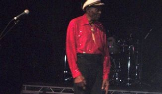 "American guitarist, singer and songwriter, Chuck Berry returns to the stage to thank the crowd and perform his famous ""heel scoot"" after he left to be examined by ambulance medics at a show in Chicago, Saturday, Jan. 1, 2011. A Chicago fire official says 84-year-old rock-and-roll legend Chuck Berry felt ill and was checked out by ambulance medics at the show. Fire Department spokesman Joe Roccasalva said Berry felt better and signed a release.  (AP Photo/Steve Handwerker) MANDATORY CREDIT"