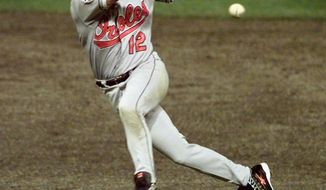 FILE - In this Oct. 12, 1997, file photo, Baltimore Orioles' Roberto Alomar throws out Cleveland Indians' Bip Roberts to end the fourth inning of Game 4 of the American League Championship Series at Jacobs Field in Cleveland, Ohio. Alomar and Bert Blyleven hope they're on deck for the Hall of Fame when the results from the Baseball Writers' Association of America election are released Wednesday, Jan. 5, 2011. (AP Photo/Jim Mone, File)