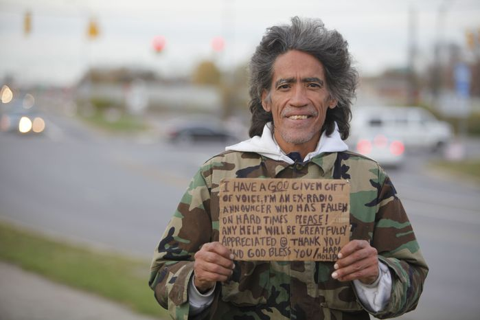 In this photo taken in late December, 2010, Ted Williams holds a sign advertising his smooth radio voice near a highway ramp in Columbus, Ohio. Mr. Williams, who is homeless, became an online video sensation when the Columbus Dispatch posted a video of him speaking in his deep baritone voice on its website this week. The Cleveland Cavaliers contacted him on Wednesday, Jan. 5, 2011, to offer him an announcing job. (AP Photo/Columbus Dispatch, Doral Chenoweth III)