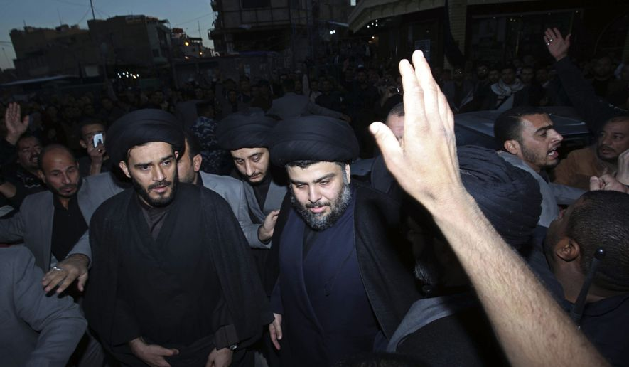 Anti-American cleric Muqtada al-Sadr, center, is surrounded by supporters in the Shi'ite city of Najaf, 100 miles south of Baghdad, Iraq, Wednesday, Jan. 5, 2011. Mr. al-Sadr, who led several Shi'ite uprisings against American forces in Iraq before going into exile in neighboring Iran almost four years ago, returned to Iraq Wednesday. (AP Photo/Alaa al-Marjani)