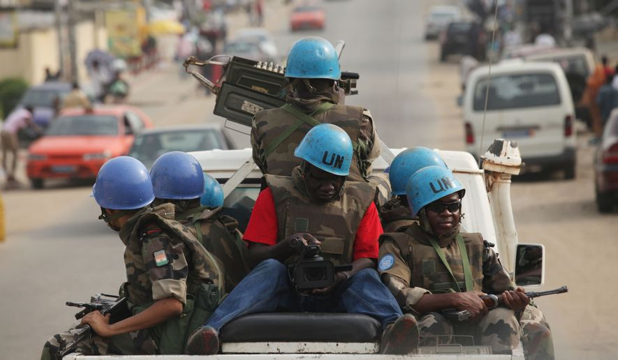 U.N. troops from Niger patrol the streets of Abidjan, Ivory Coast, on Tuesday, Jan. 4, 2011. Nigeria's president warned Tuesday that a solution to Ivory Coast's deepening political crisis will take time, after the internationally recognized winner of the election said a military intervention now should be considered to oust the incumbent. (AP Photo/Sunday Alamba)