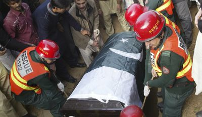 Pakistanis bury Punjab Gov. Salman Taseer, who enraged Muslims by opposing laws that decreed death for insulting Islam and was slain by a bodyguard. (Associated Press)