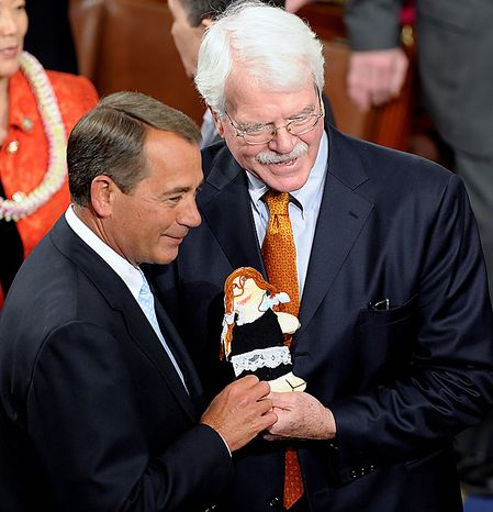 House Speaker-desigante John Boehner of Ohio, left, poses for a photo with Rep. George Miller, California Democrat, and a flat Stacie doll, on Capitol Hill in Washington, Wednesday, Jan. 5, 2011, during the first session of the 112th Congress.  (AP Photo/Susan Walsh)