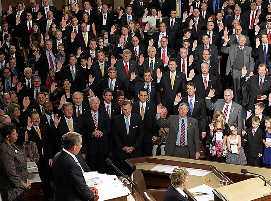 House Speaker John Boehner of Ohio delivers the oath of office to Republican members of the House of Representatives during the first session of the 112th Congress, on Capitol Hill in Washington, Wednesday, Jan. 5, 2011. (AP Photo/Susan Walsh)