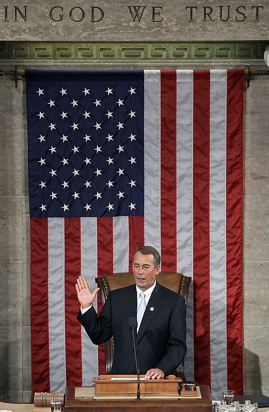 House Speaker John Boehner of Ohio takes the oath of office during the first session of the 112th Congress, on Capitol Hill in Washington, Wednesday, Jan. 5, 2011.  (AP Photo/Charles Dharapak)