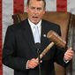 **FILE** House Speaker John A. Boehner, Ohio Republican, holds up the gavel during his acceptance speech on Jan. 5 at the first session of the 112th Congress on Capitol Hill. (Associated Press)