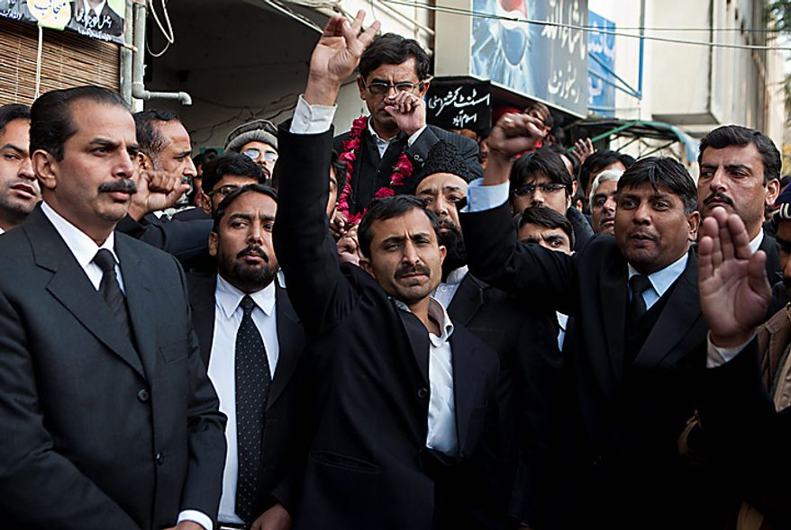 Pakistani lawyers chant slogans in favor of Mumtaz Qadri, alleged killer of Punjab Gov. Salman Taseer, during his appearance in a court in Islamabad, Pakistan, on Wednesday, Jan. 5, 2011. Mr. Taseer was killed on Tuesday allegedly by his bodyguard commando, who reportedly was enraged by Mr. Taseer's opposition to laws decreeing death for insulting Islam. (AP Photo/B.K. Bangash)