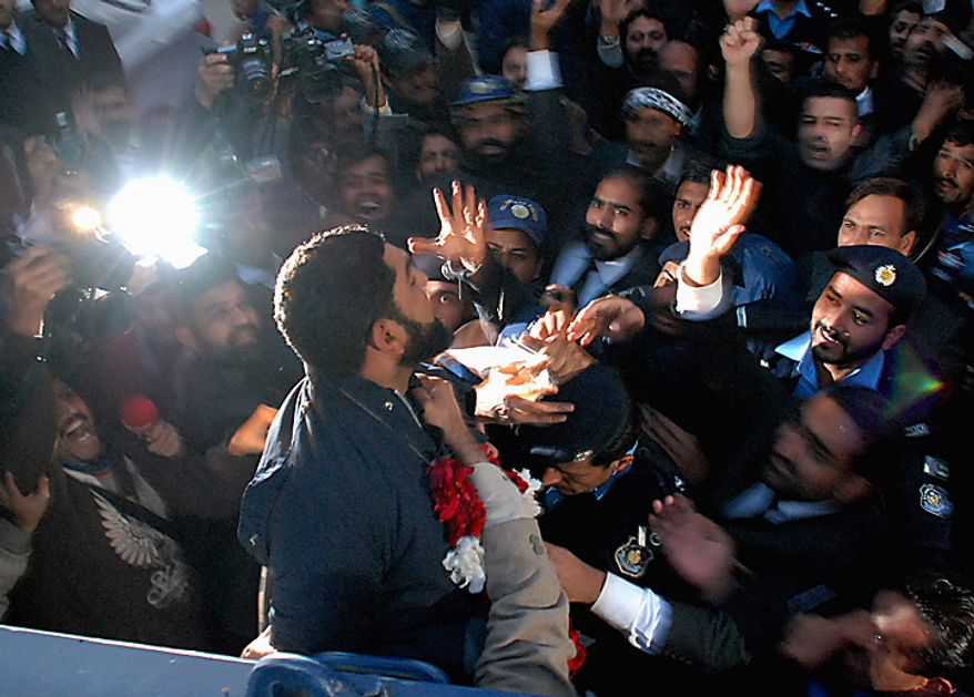 Mumtaz Qadri, foreground, alleged killer of Punjab Gov. Salman Taseer, leaves a court in Islamabad, Pakistan, on Wednesday, Jan. 5, 2011. Mr. Taseer was killed on Tuesday allegedly by his bodyguard commando, who reportedly was enraged by Mr. Taseer's opposition to laws decreeing death for insulting Islam. (AP Photo/Mohammad Riazur Rehman)