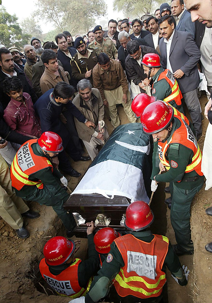 Pakistani rescue workers and mourners bury the coffin of Punjab Gov. Salman Taseer in a cemetry in Lahore, Pakistan, on Wednesday, Jan. 5, 2011. (AP Photo/Ahmad Sheraz)