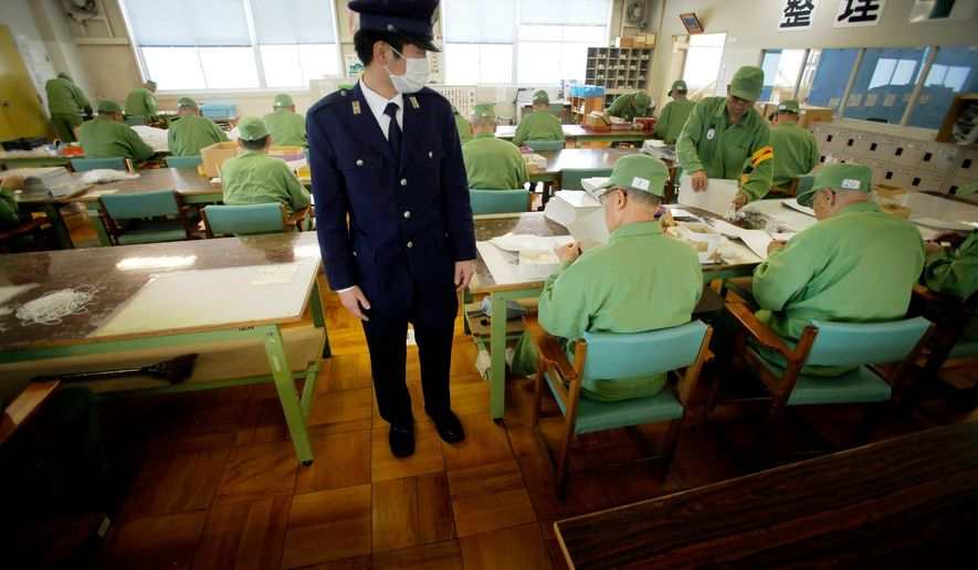 A guard at Onomichi Prison in Onomichi, Japan, near Hiroshima, watches elderly inmates work during their six-hour labor shift. Japan's population is aging faster than any other nation's, and that means increased numbers of elderly prisoners. (Associated Press)