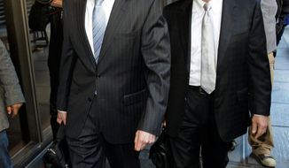 Anna Nicole Smith's longtime companion, Howard K. Stern (left), and his attorney, Steve Sadow, leave Los Angeles Superior Court on Thursday, after a judge voided his conviction. (Associated Press)