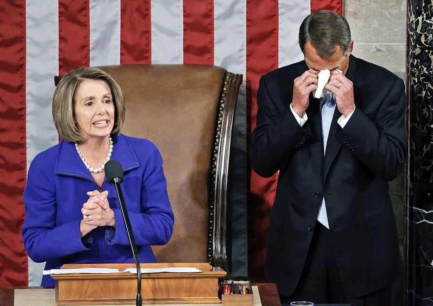 TEARS OF JOY: Mr. Boehner wipes away tears as he waits to receive that gavel from outgoing House Speaker Nancy Pelosi, California Democrat. Mrs. Pelosi served two terms as the House's top member. (Associated Press)