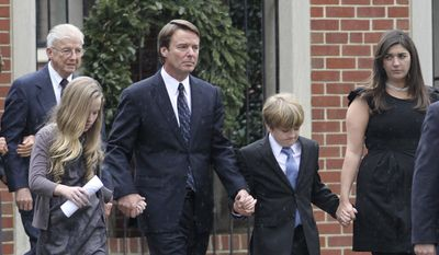 Former Democratic presidential candidate John Edwards and his children, Emma Claire, left, Jack and Cate, far right, leave the funeral service for Elizabeth Edwards at Edenton Street United Methodist Church in Raleigh, N.C., on Dec. 11, 2010. The will Elizabeth Edwards signed days before her death last month makes no mention of her estranged husband. (AP Photo/Jim R. Bounds, File)