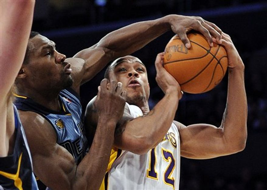 Memphis Grizzlies guard Tony Allen, left, blocks the shot of Los Angeles Lakers guard Shannon Brown during the second half of their NBA basketball game, Sunday, Jan. 2, 2011, in Los Angeles. (AP Photo/Mark J. Terrill)