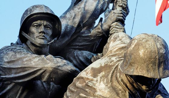 ** FILE ** The faces of the Marines on the Iwo Jima war memorial in Arlington, Va., show the problems that the elements have caused over the years. Funds are being raised to make improvements to the monument, including a museum-grade cleaning and wax sealing. (Rod Lamkey Jr./Special to The Washington Times)