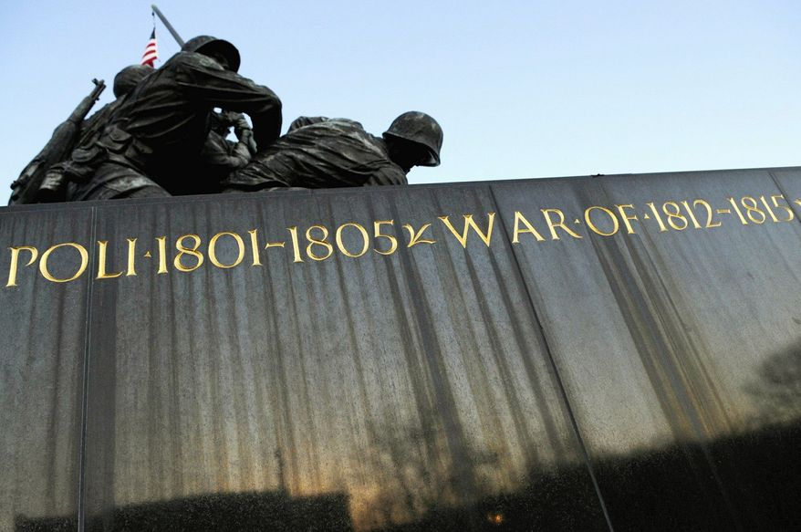 TIME TAKES ITS TOLL: On the marble wall of the memorial where the history of battles is etched in gold, decay is visible in the streaks on the monument and the chips in the paint. (Rod Lamkey Jr./Special to The Washington Times)