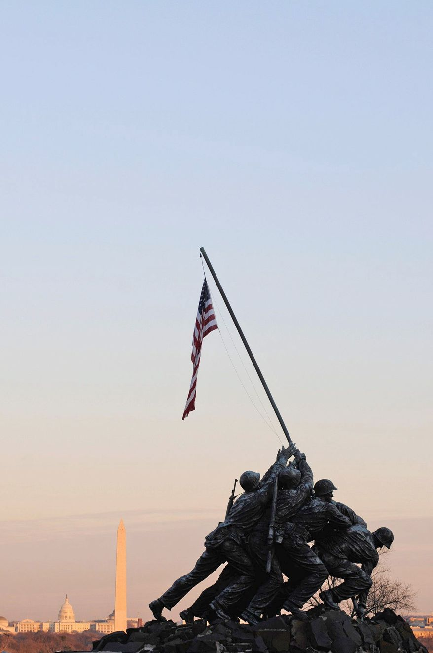 Funds are being raised to make improvements to the Iwo Jima war memorial, including a museum-grade cleaning and wax sealing. (Rod Lamkey Jr./Special to The Washington Times)
