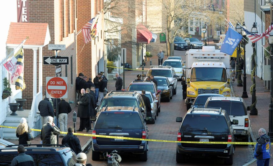 Frances Street in Annapolis, Md., is blocked off as officials probe a suspicious package at a state office building Thursday. A similar package was sent to Hanover, Md. (Associated Press)
